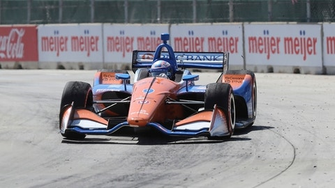 Scott Dixon drives through the first turn during the first race of the IndyCar Detroit Grand Prix auto racing doubleheader, Saturday, June 2, 2018, in Detroit. (AP Photo/Carlos Osorio)