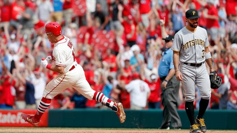 St. Louis Cardinals' Kolten Wong, left, rounds the bases past Pittsburgh Pirates first baseman Sean Rodriguez after hitting a walk-off home run during the ninth inning of a baseball game Saturday, June 2, 2018, in St. Louis. The Cardinals won 3-2. (AP Photo/Jeff Roberson)