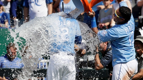 Kansas City Royals' Jorge Soler (12) is doused by teammate Salvador Perez (13) following a baseball game against the Oakland Athletics at Kauffman Stadium in Kansas City, Mo., Saturday, June 2, 2018. (AP Photo/Orlin Wagner)