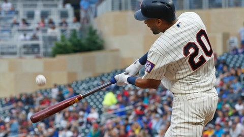Minnesota Twins' Eddie Rosario hits a two-run home run off Cleveland Indians pitcher Trevor Bauer in the third inning of a baseball game Saturday, June 2, 2018, in Minneapolis. (AP Photo/Jim Mone)