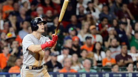 Boston Red Sox's Andrew Benintendi watches his two-run home run against the Houston Astros during the seventh inning of a baseball game Saturday, June 2, 2018, in Houston. (AP Photo/David J. Phillip)