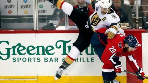 Washington Capitals forward Lars Eller (20), of Denmark, checks Vegas Golden Knights defenseman Luca Sbisa (47), of Italy, during the second period in Game 3 of the NHL hockey Stanley Cup Final, Saturday, June 2, 2018, in Washington. (AP Photo/Pablo Martinez Monsivais)