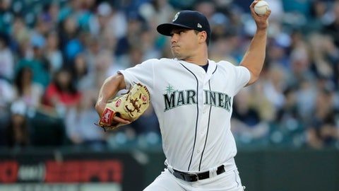 Seattle Mariners starting pitcher Marco Gonzales throws against the Tampa Bay Rays during the first inning of a baseball game, Saturday, June 2, 2018, in Seattle. (AP Photo/Ted S. Warren)