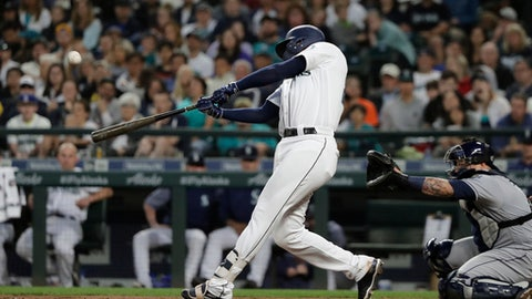 Seattle Mariners' Ryon Healy hits a solo home run against the Tampa Bay Rays during the sixth inning of a baseball game Saturday, June 2, 2018, in Seattle. (AP Photo/Ted S. Warren)
