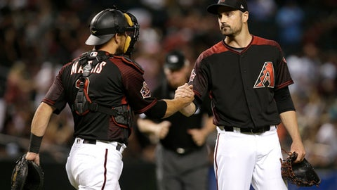 Arizona Diamondbacks pitcher T.J. McFarland and Jeff Mathis (2) celebrate after the Diamondbacks defeated the Miami Marlins 6-2 during a baseball game Saturday, June 2, 2018, in Phoenix. (AP Photo/Rick Scuteri)