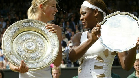 In this Saturday July 3, 2004 file image Russia's Maria Sharapova, left, holds the winner's trophy with Serena Williams holding the runners up trophy after the presentation of the Women's Singles final on the Centre Court at Wimbledon. The fourth-round French Open match between Sunday June 3, 2018, Serena Williams and Maria Sharapova will be their 22nd head-to-head meeting. Williams has won 19 of 21 so far, including 18 in a row. Both of Sharapova's victories came 14 years ago, including in the 2004 Wimbledon final. (AP Photo/Anja Niedringhaus)