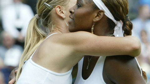 In this Saturday July 3, 2004 file image Russia's Maria Sharapova embraces Serena Williams, after defeating her to win the Women's Singles final on the Centre Court at Wimbledon. The fourth-round French Open match between, Serena Williams and Maria Sharapova, Sunday June 3, 2018, will be their 22nd head-to-head meeting. Williams has won 19 of 21 so far, including 18 in a row. Both of Sharapova's victories came 14 years ago, including in the 2004 Wimbledon final.(AP Photo/Dave Caulkin)
