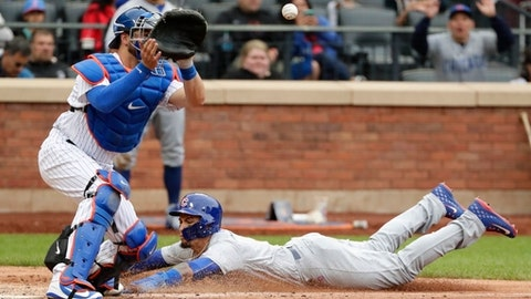 Chicago Cubs' Javier Baez, right, slides past New York Mets catcher Kevin Plawecki to steal home during the seventh inning of a baseball game Sunday, June 3, 2018, in New York. (AP Photo/Frank Franklin II)