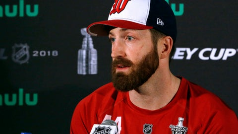 Washington Capitals defenseman Brooks Orpik speaks to the media, Sunday, June 3, 2018, at Kettler Capitals Iceplex in Arlington, Va. The Capitals will host the Vegas Golden Knights in Game 4 of the NHL hockey Stanley Cup Final on Monday night in Washington. (AP Photo/Bill Sikes)