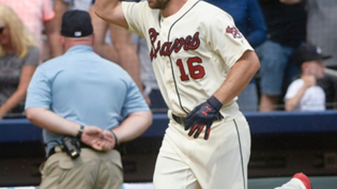 Atlanta Braves shortstop Charlie Culberson (16) runs the baseline after hitting a two-run home run to end a baseball game against the Washington Nationals, Sunday, June 3, 2018, in Atlanta. The Braves won 4-2. (AP Photo/John Amis)