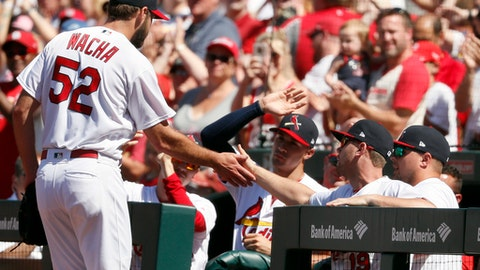 St. Louis Cardinals starting pitcher Michael Wacha is congratulated by teammates after being removed during the ninth inning of a baseball game against the Pittsburgh Pirates, Sunday, June 3, 2018, in St. Louis. (AP Photo/Jeff Roberson)