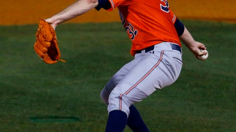 File-This May 24, 2018, file photo shows Auburn pitcher Casey Mize throwing during the first inning of a Southeastern Conference tournament NCAA college baseball game against Texas A&M in Hoover, Ala.  Mize has dazzled scouts for months with his impressive arsenal of pitches. The tantalizingly talented Auburn right-hander could find himself leading off the Major League Baseball draft on Monday night, with the Detroit Tigers ready to go on the clock with the No. 1 pick. (AP Photo/Butch Dill, File)