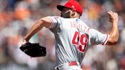 Philadelphia Phillies starting pitcher Jake Arrieta (49) delivers against the San Francisco Giants during the second inning of a baseball game, Sunday, June 3, 2018, in San Francisco. (AP Photo/D. Ross Cameron)