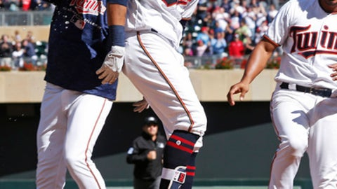 Minnesota Twins' Eddie Rosario gets a water dousing after his walkoff, two-run home run off Cleveland Indians' pitcher Cody Allen in the ninth inning of a baseball game Sunday, June 3, 2018, in Minneapolis. It was Rosario's third home run of the game as the Twins defeated the Indians 7-5. (AP Photo/Jim Mone)