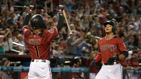 Arizona Diamondbacks Jarrod Dyson (1) and Ketel Marte score runs on a sacrifice by Daniel Descalso in the seventh inning during a baseball game against the Miami Marlins, Sunday, June 3, 2018, in Phoenix. (AP Photo/Rick Scuteri)