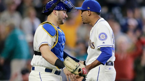 Seattle Mariners closing pitcher Edwin Diaz and catcher Mike Zunino greet each other after the 2-1 win over the Tampa Bay Rays in a baseball game on Sunday, June 3, 2018, in Seattle. (AP Photo/John Froschauer)