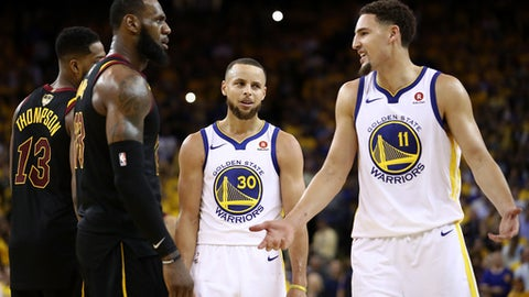 OAKLAND, CA - MAY 31:  Stephen Curry #30 and Klay Thompson #11 of the Golden State Warriors exchange words with LeBron James #23 of the Cleveland Cavaliers in overtime during Game 1 of the 2018 NBA Finals at ORACLE Arena on May 31, 2018 in Oakland, California. (Photo by Ezra Shaw/Getty Images)