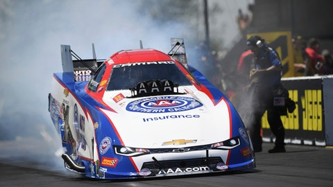 In this photo provided by the NHRA, Robert Hight, the defending Funny Car world champion, powered his Auto Club Chevrolet Camaro SS in the final round at the 21st annual JEGS Route 66 NHRA Nationals at Route 66 Raceway. (Mark Gewertz/NHRA via AP)