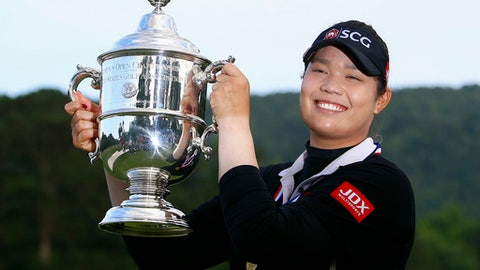 Ariya Jutanugarn, of Thailand, holds up the trophy after winning in a four hole playoff during the final round of the U.S. Women's Open golf tournament at Shoal Creek, Sunday, June 3, 2018, in Birmingham, Ala. (AP Photo/Butch Dill)