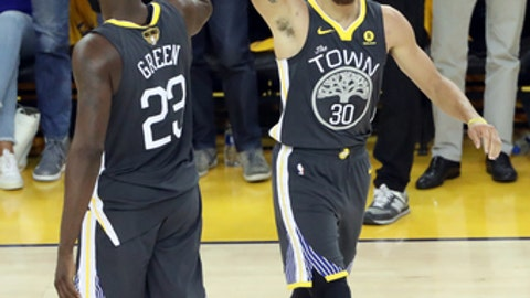 OAKLAND, CA - JUN 3: Stephen Curry #30 and Draymond Green #23 of the Golden State Warriors celebrate during the game against the Cleveland Cavaliers in Game Two of the 2018 NBA Finals on June 3, 2018 at ORACLE Arena in Oakland, California. (Photo by Joe Murphy/NBAE via Getty Images)