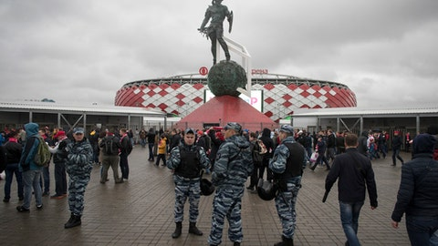 In this photo taken on Wednesday, April 18, 2018, police officers guard before a Russian Premier League Championship soccer match between Spartak Moscow and Tosno, with the World Cup Spartak stadium in the background, in Moscow, Russia. The World Cup marks a moment of pride for President Vladimir Putin, a long-sought opportunity to showcase Russias achievements and bolster its international prestige. The Russian leader has made security of the tournament the top priority, ordering sweeping measures to fend off any potential threats from the ground, sea or air. But despite the strict security regime, threats abound in Russia, which has faced an Islamist rebellion in the south and waged a military campaign in Syria. (AP Photo/Pavel Golovkin)