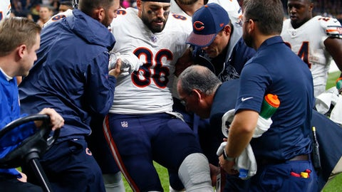 FILE - In this Oct. 29, 2017, file photo, Chicago Bears tight end Zach Miller (86) is placed on a cart after injuring his leg in the second half of an NFL football game against the New Orleans Saints in New Orleans. The Bears have re-signed veteran tight end Zach Miller to a one-year contract, clearing the way for him to return from a gruesome injury last October that nearly cost him his left leg.(AP Photo/Butch Dill, File)