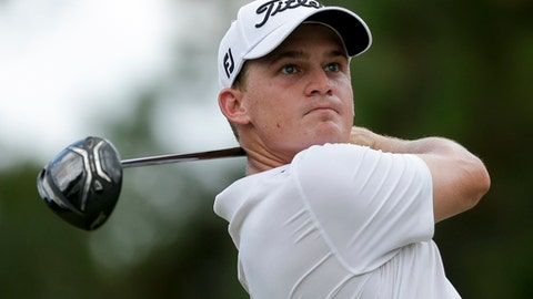 "FILE - In this Aug. 12, 2017, file photo, Bud Cauley watches his tee shot on the third hole during the third round of the PGA Championship golf tournament at the Quail Hollow Club, in Charlotte, N.C. Cauley says he's thankful to be alive after a car accident over the weekend on what he describes as the ""scariest night of my life."" Cauley, 28, was riding with three other people in a car involved in an accident late Friday, June 1, 2018, following the second round of the Memorial. Cauley posted a message on Instagram saying he had surgery on Sunday. (AP Photo/Chuck Burton, File)"