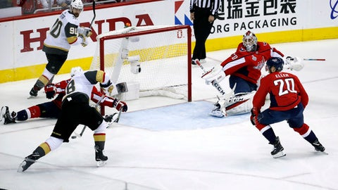 Vegas Golden Knights forward James Neal (18) aims a shot at an open net as Washington Capitals goaltender Braden Holtby, right, defends during the first period in Game 4 of the NHL hockey Stanley Cup Final, Monday, June 4, 2018, in Washington. Neal missed the shot. (AP Photo/Pablo Martinez Monsivais)