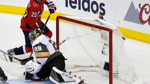 Washington Capitals forward Devante Smith-Pelly (25) scores a goal past Vegas Golden Knights goaltender Marc-Andre Fleury (29) during the first period in Game 4 of the NHL hockey Stanley Cup Final, Monday, June 4, 2018, in Washington. (AP Photo/Pablo Martinez Monsivais)