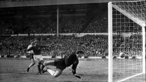 FILE - In this July 30, 1966 file photo, a shot from Geoff Hurst bounces down from the West Germany crossbar during the World Cup final at London's Wembley Stadium. The linesman gave it as a goal and England went to to win 4-2. The 21st World Cup begins on Thursday, June 14, 2018, when host Russia takes on Saudi Arabia.  (AP Photo/File)