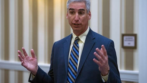FILE - In this Jan. 16, 2015, file photo, Oliver Luck speaks with members of the media at the NCAA Convention in Oxon, Md. Former NFL quarterback Oliver Luck is leaving his high-ranking position at the NCAA to become commissioner of the XFL, the second edition of professional wrestling mogul Vince McMahon's football league. McMahon announced the hire four months after unveiling plans to relaunch the XFL, which folded in 2001 after its only season. The new XFL is scheduled to begin in 2020. (AP Photo/Cliff Owen, File)