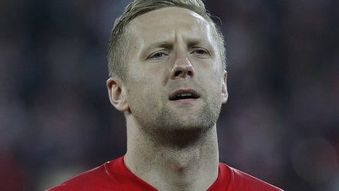 Poland's Kamil Glik stands for the national anthem of his country before an international friendly soccer match between Poland and South Korea in Chorzow, Poland, Tuesday, March 27, 2018.(AP Photo/Czarek Sokolowski)