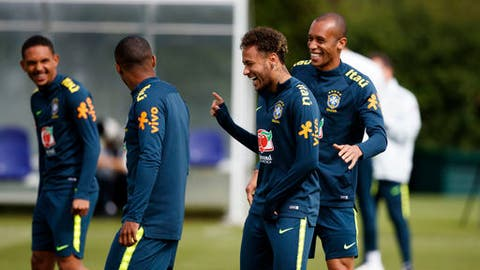 Brazil's Neymar laughs during the training session at Enfield Training Ground, London, Britain, Tuesday June 5, 2018. (John Walton/PA via AP)