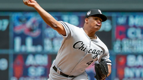 Chicago White Sox starting pitcher Reynaldo Lopez throws to the Minnesota Twins in the first inning in game 1 of a doubleheader baseball game Tuesday, June 5, 2018, in Minneapolis. As a makeup game from Jackie Robinson Day, all players and coaches wear 42. (AP Photo/Bruce Kluckhohn)