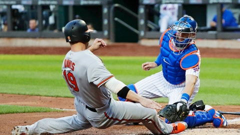 New York Mets catcher Kevin Plawecki, right, tags out Baltimore Orioles' Chris Davis (19) at home plate during the second inning of a baseball game Tuesday, June 5, 2018, in New York. (AP Photo/Frank Franklin II)