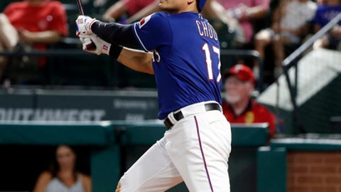 Texas Rangers' Shin-Soo Choo watches his two-run home run against the Oakland Athletics during the seventh inning of a baseball game Tuesday, June 5, 2018, in Arlington, Texas. (AP Photo/Michael Ainsworth)