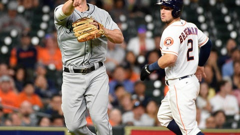 Seattle Mariners third baseman Kyle Seager, left, throws out Houston Astros' Carlos Correa to end the eighth inning as Alex Bregman, right, watches during a baseball game Tuesday, June 5, 2018, in Houston. (AP Photo/Eric Christian Smith)