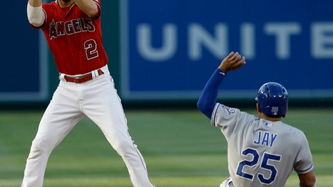 Kansas City Royals' Jon Jay, right, is forced out at second by Los Angeles Angels shortstop Andrelton Simmons on a grounder by Mike Moustakas, who was safe at first during the first inning of a baseball game in Anaheim, Calif., Tuesday, June 5, 2018. (AP Photo/Alex Gallardo)