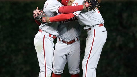Philadelphia Phillies' Nick Williams, left, Odubel Herrera, center and Aaron Altherr celebrate the team's 6-1 win over the Chicago Cubs in a baseball game Tuesday, June 5, 2018, in Chicago. (AP Photo/Charles Rex Arbogast)