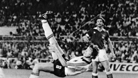 FILE - In this July 8, 1982 file photo, West Germany's Klaus Fischer scores the third goal and equalizes, in the World Cup semifinal soccer match against France, in Seville, Spain. West Germany defeats France in a penalty shoot out after a 3-3 draw. The 21st World Cup begins on Thursday, June 14, 2018, when host Russia takes on Saudi Arabia.  (AP Photo/File)