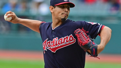 Cleveland Indians starting pitcher Carlos Carrasco throws in the first inning of a baseball game against the Milwaukee Brewers, Wednesday, June 6, 2018, in Cleveland. (AP Photo/David Dermer)