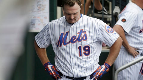 New York Mets' Jay Bruce returns to the dugout after flying out during the ninth inning of a baseball game against the Baltimore Orioles at Citi Field, Wednesday, June 6, 2018, in New York. The Orioles defeated the Mets 1-0. (AP Photo/Seth Wenig)