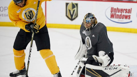 Vegas Golden Knights goaltender Marc-Andre Fleury blocks a shot tipped by right wing Ryan Reaves during an NHL hockey practice Wednesday, June 6, 2018, in Las Vegas. (AP Photo/John Locher)
