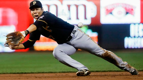 FILE - In this Friday, Sept. 16, 2016 file photo, Pittsburgh Pirates third baseman Jung Ho Kang misses a double hit by Cincinnati Reds' Adam Duvall in the first inning of a baseball game in Cincinnati. Pittsburgh Pirates infielder Jung Ho Kang said he has been sober since his third DUI arrest in December 2016 and is focused on getting into baseball shape and returning to the Pirates. (AP Photo/John Minchillo, File)