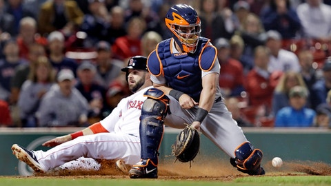 Detroit Tigers catcher James McCann, right, fields a late throw as Boston Red Sox's Mitch Moreland scores on a single by Sam Travis during the eighth inning of a baseball game at Fenway Park in Boston, Wednesday, June 6, 2018. (AP Photo/Charles Krupa)
