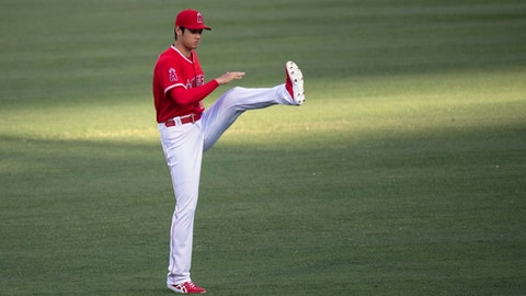Los Angeles Angels starting pitcher Shohei Ohtani warms up before a baseball game in Anaheim, Calif., Wednesday, June 6, 2018. (AP Photo/Kyusung Gong)