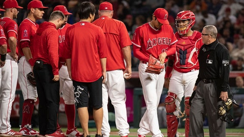 Los Angeles Angels starting pitcher Shohei Ohtani, third from right, is removed from the baseball game against the Kansas City Royals during the fifth inning in Anaheim, Calif., Wednesday, June 6, 2018. (AP Photo/Kyusung Gong)