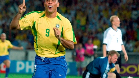 FILE - In this June 30, 2002, file photo, Brazil's Ronaldo celebrates scoring against Germany during the World Cup soccer final at the Yokohama stadium in Yokohama, Japan. Brazil won the match 2-0 with Ronaldo scoring both goals. The 21st World Cup begins on Thursday, June 14, 2018, when host Russia takes on Saudi Arabia. (AP Photo/Dusan Vranic, File)