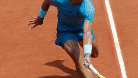 Spain's Rafael Nadal returns a shot against Argentina's Diego Schwartzman during their quarterfinal match of the French Open tennis tournament at the Roland Garros stadium in Paris, France, Thursday, June 7, 2018. (AP Photo/Alessandra Tarantino)