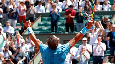 Spain's Rafael Nadal celebrates winning his quarterfinal match of the French Open tennis tournament against Argentina's Diego Schwartzman in four sets 4-6, 6-3, 6-2, 6-2, at the Roland Garros stadium in Paris, France, Thursday, June 7, 2018. (AP Photo/Thibault Camus)